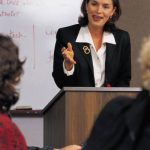 Woman speaking at meeting