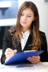 Businesswoman writing some documents