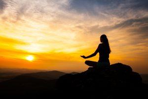 Yoga practicioner in sunset