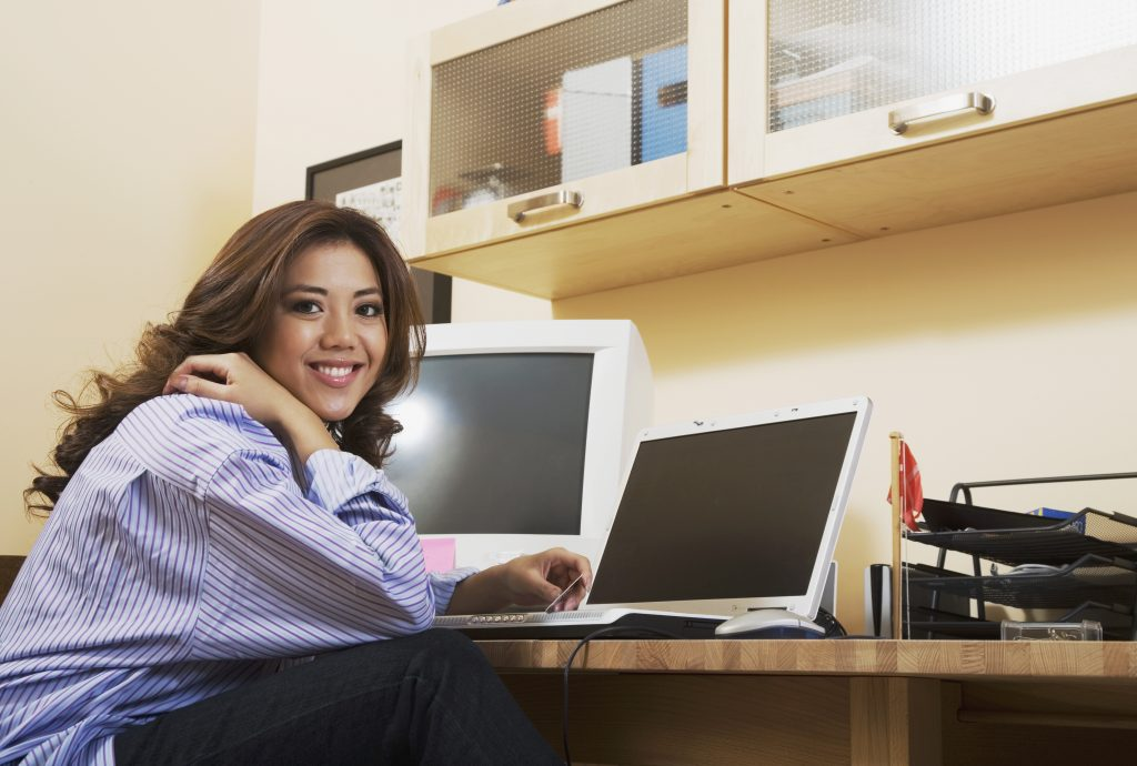 Hispanic woman in home office
