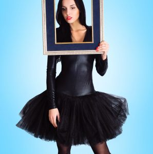 Woman wearing in black dress holding picture frame