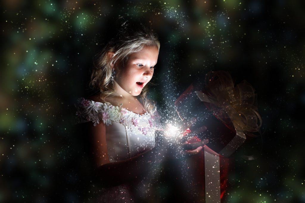 Child opening a magic gift box
